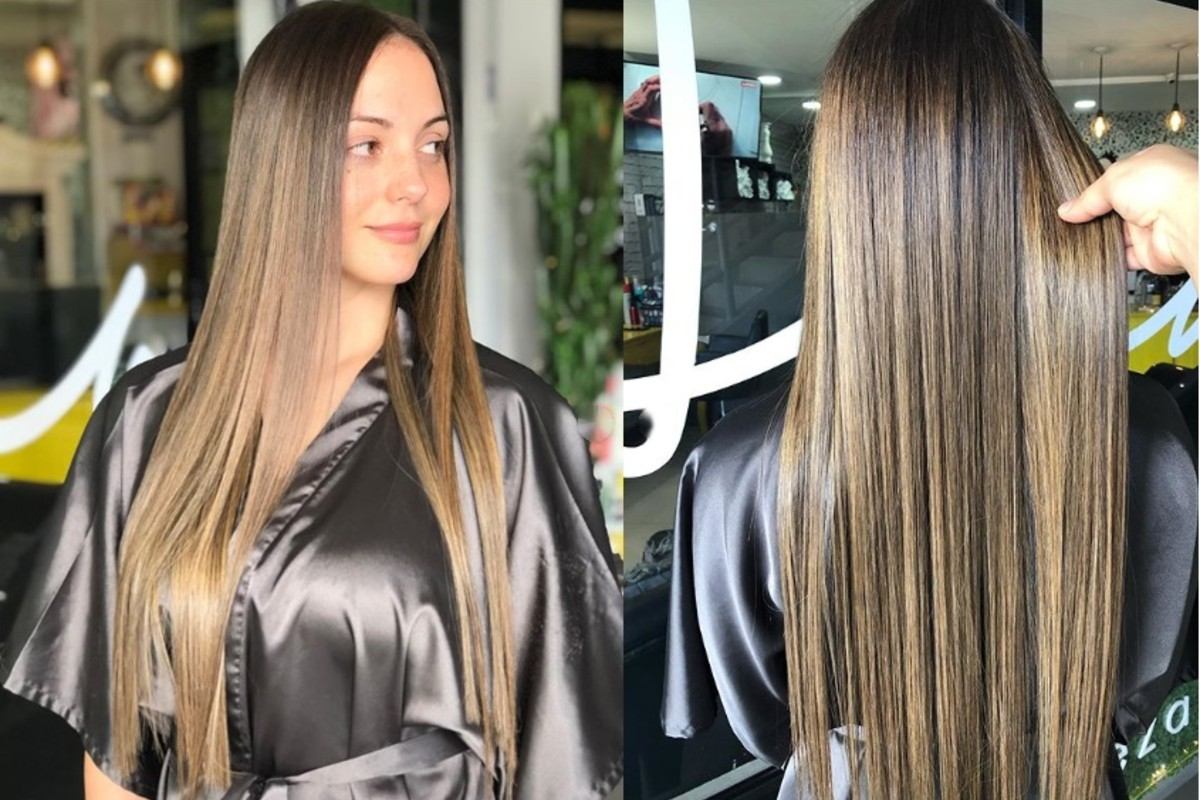 Hair straightened by flat iron in salon