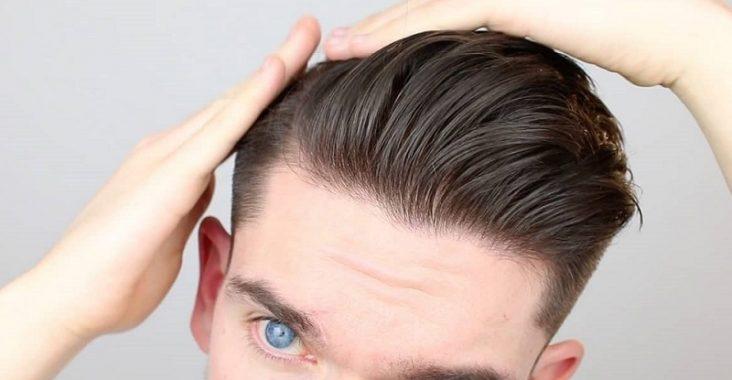 man using hair clay