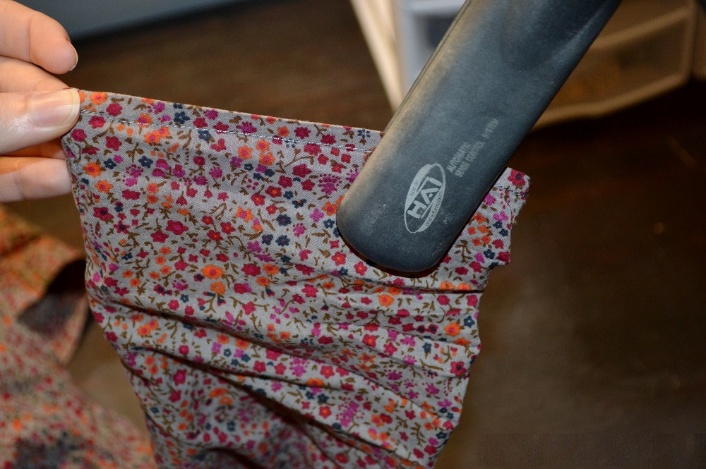 ironing clothes with flat iron